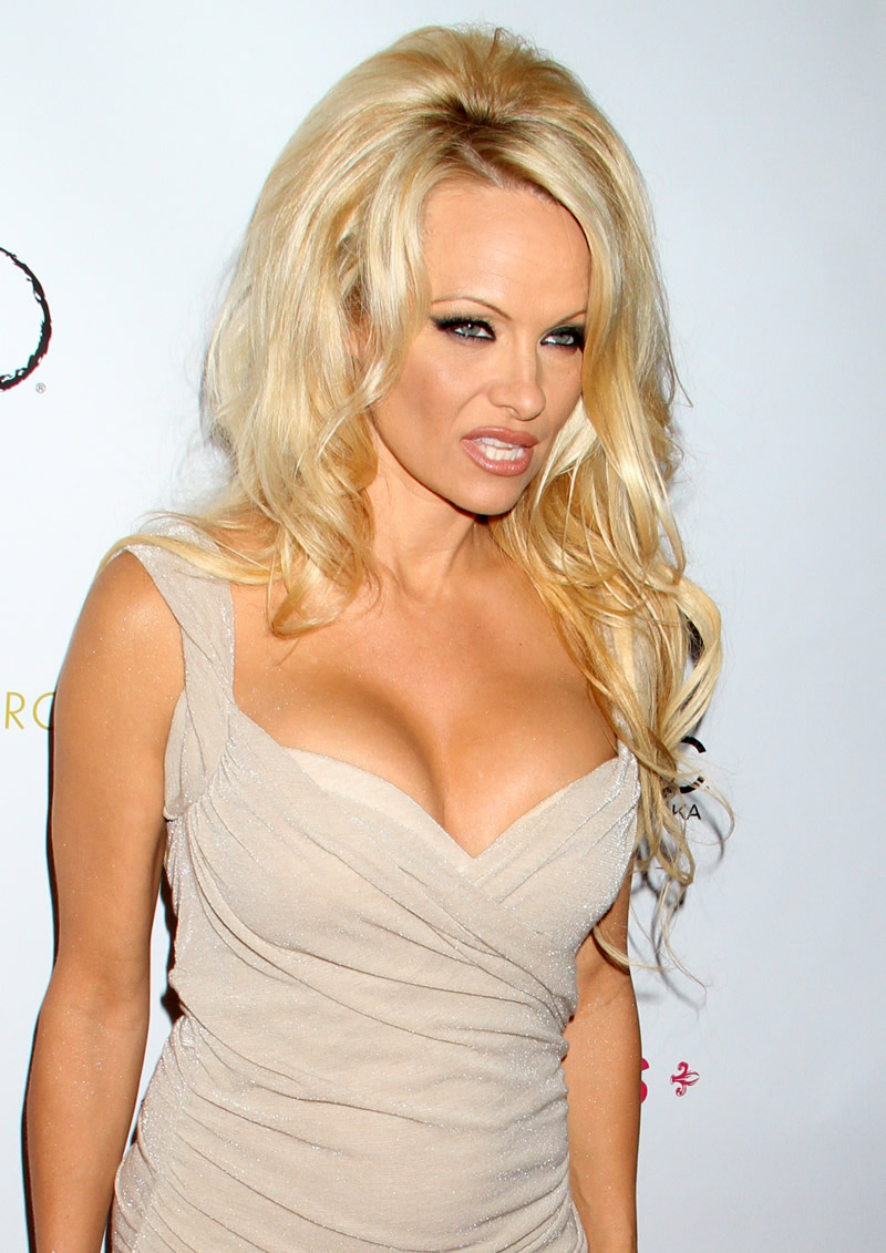 Louboutin pumps are sexy: Pamela Anderson in extremely low ... Pamela Anderson