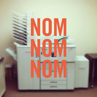 "Photo of office photocopier with words ""Nom, Nom, Nom"" overlaid over it"