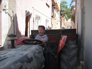 Vroom! Vroom!  A Turkish boy playing on the tractor in the old town of Ayvalik.