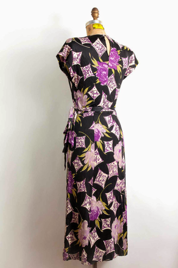 Black and purple novelty print on a mint condition 1940s dress