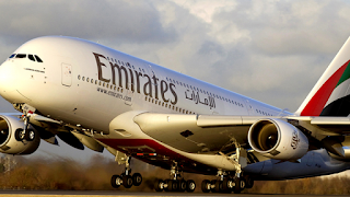 Emirates crew member dies after falling off aircraft's emergency exit