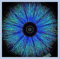 Σύγκρουση βαρέων ιόντων χρυσού στο RHIC, όπως καταγράφηκε από τον ανιχνευτή του πειράματος STAR. Φαίνονται οι τροχιές μόνο των φορτισμένων σωματιδίων, στην συντριπτική τους πλειοψηφία αδρόνια. Το πείραμα καταφέρνει να αναγνωρίσει την πλειοψηφία των χιλιάδων σωματιδίων που καταγράφονται σε κάθε σύγκρουση.