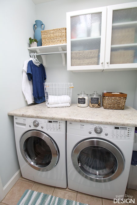 10 storage ideas for small laundry rooms scattered for Laundry room countertop over washer and dryer
