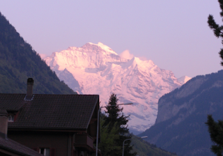 Jungfraujoch mountains at sunset in Interlaken, view outside Hotel Alpina
