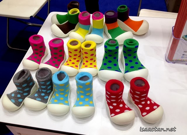 Colourful baby socks attached to a rubber baby shoe