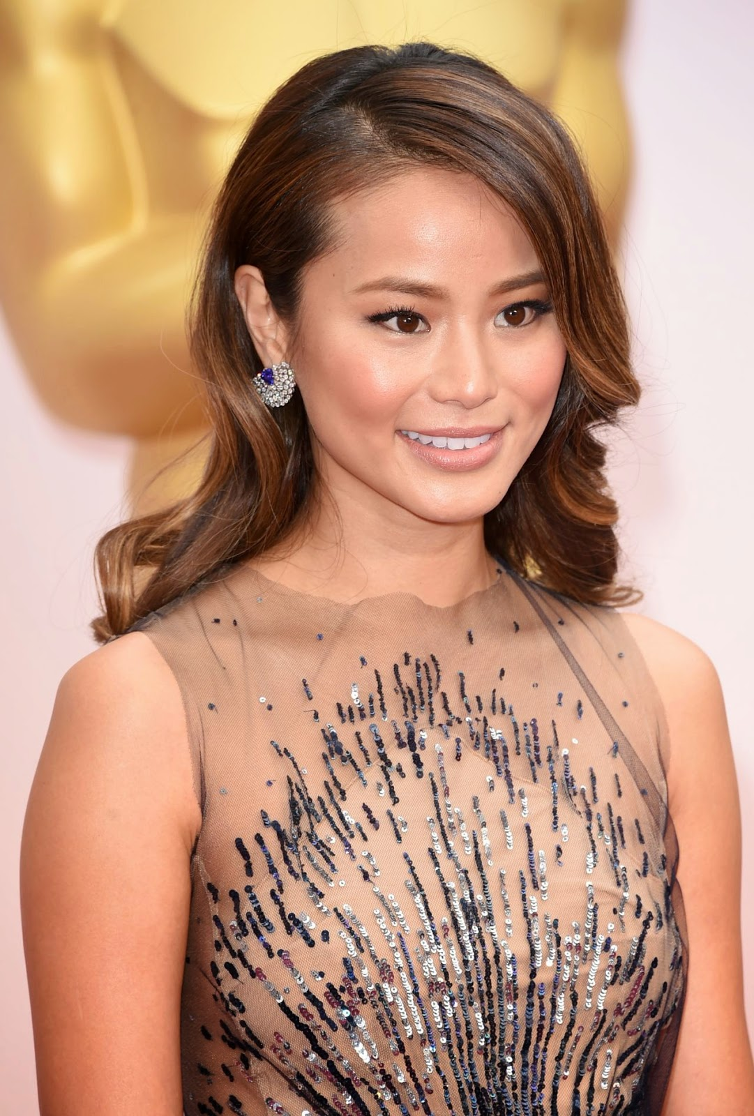 Jamie Chung wears a sequinned dress to the 2015 Oscars in Hollywood