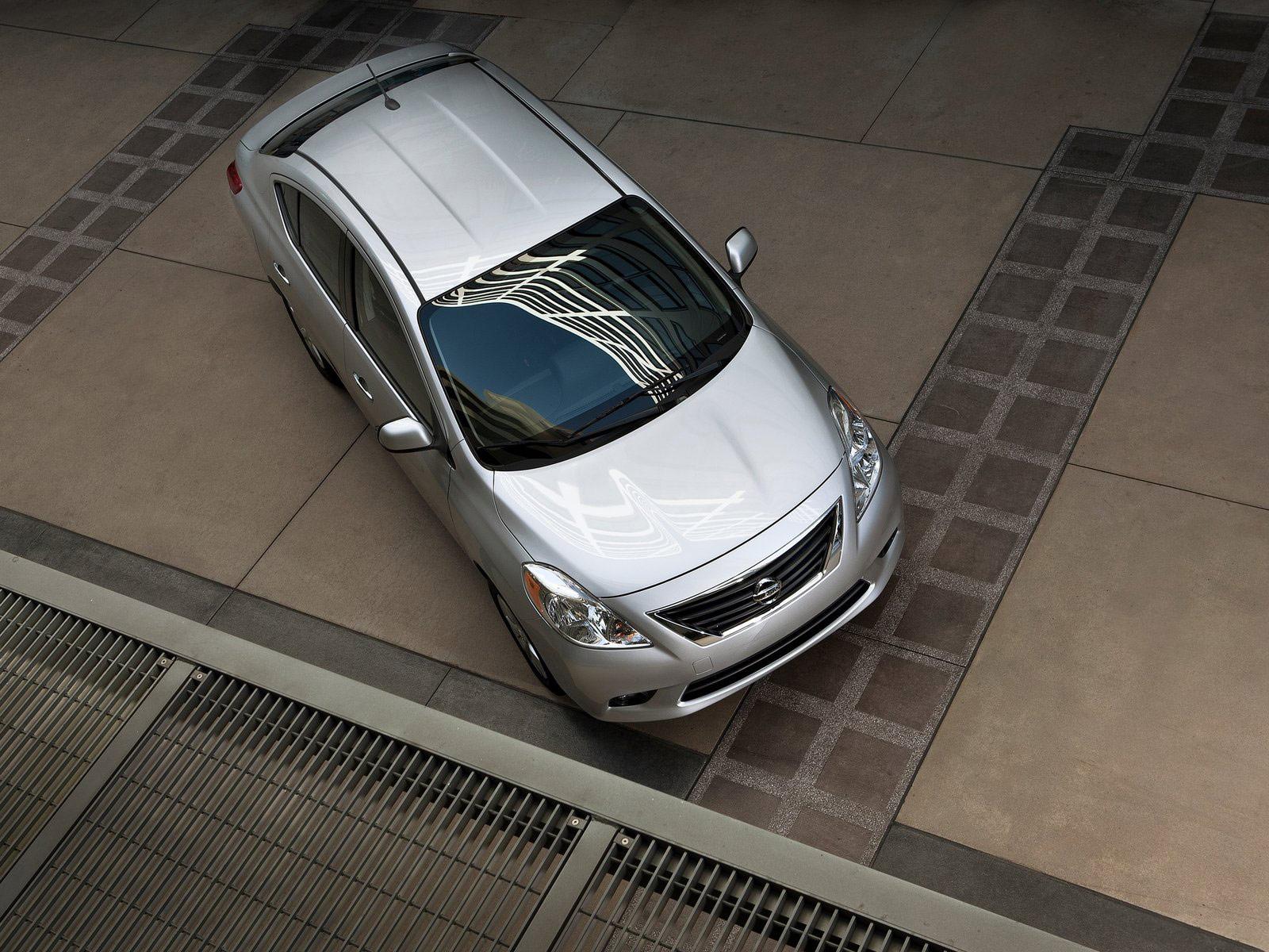 http://2.bp.blogspot.com/-Bc7Lci-VWp4/TqyFS1G7nrI/AAAAAAAAHBY/-69OBHHzWiM/s1600/Nissan_Versa_Sedan_2012_japanese-car-wallpapers_3.jpg