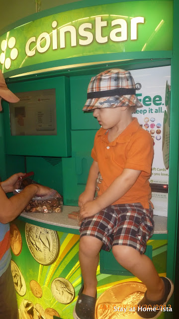 take your child to the local Coinstar machine and let them chose which charity to give their money to.