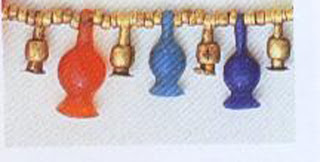 An example of New Kingdom bead production. Effigy lotus seed-pods in carnelian, gold, lapis lazuli, and feldspar; with tiny carnelian and gold spacer beads. Typical carnelian lotus pod: length, 1.5 cm. British Museum, London