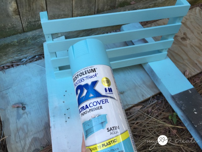 Spray painting magazine rack with rustoleum's satin aqua