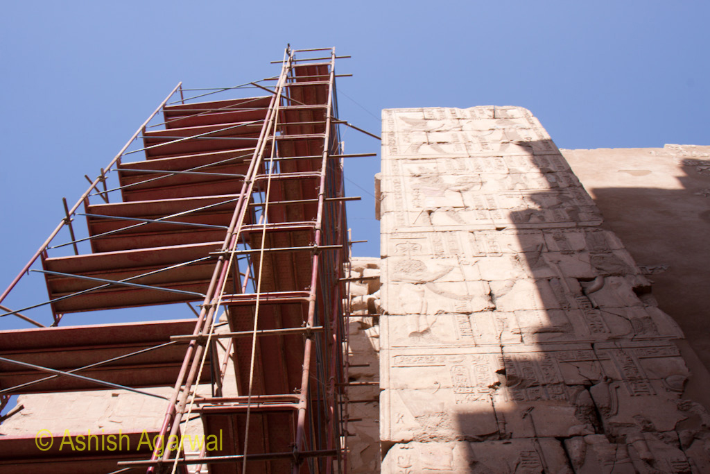 Scaffolding next to a cracked portion of wall inside the Karnak temple in Luxor