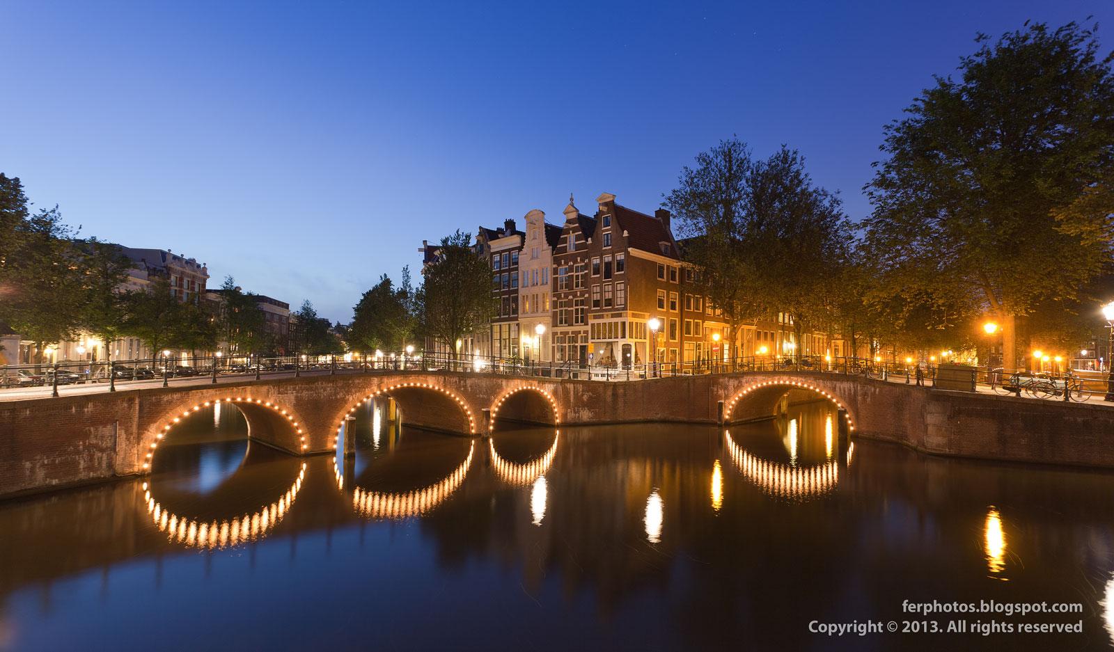 Amsterdam channels bridges Keizersgracht Leidsegracht by night city lights
