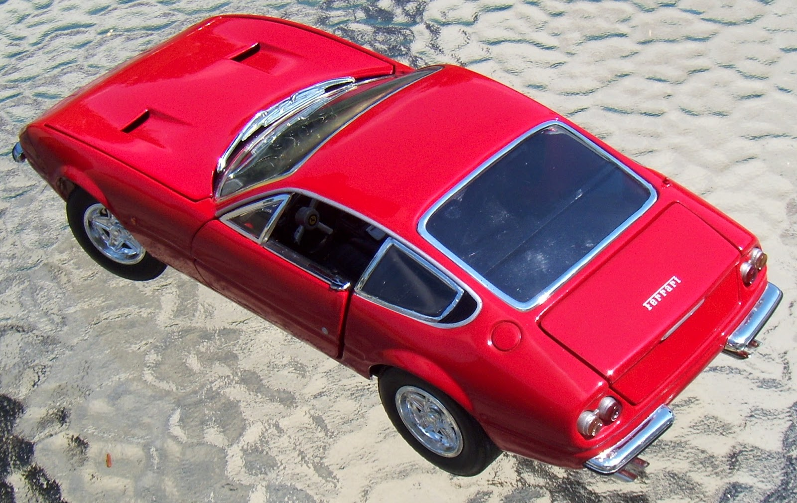The daytona was the last v 12 ferrari for a few decades as future ferrari s followed the lines of the dino 246 with a mid engine setup and wedge profile