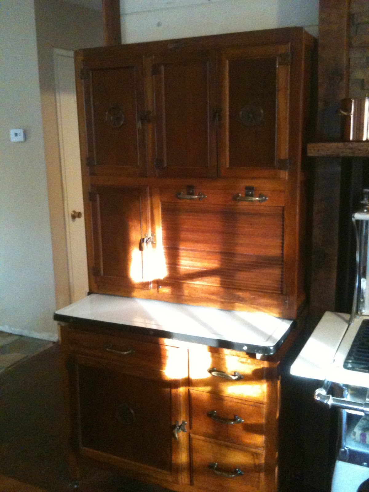 drawers and a large cabinet, and the slideout enamel counter surface