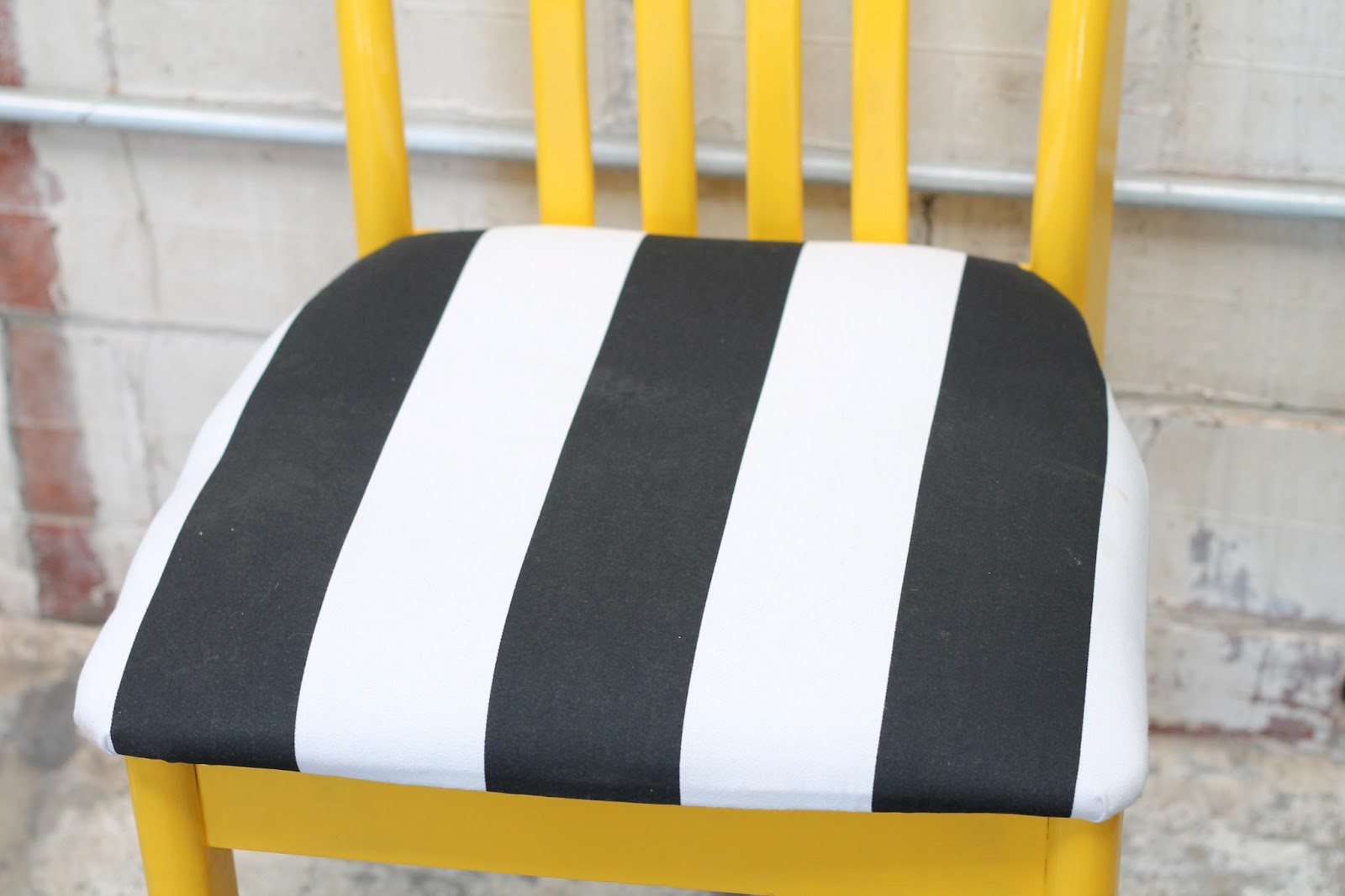 Yellow Painted Chair With Black And White Striped Seat