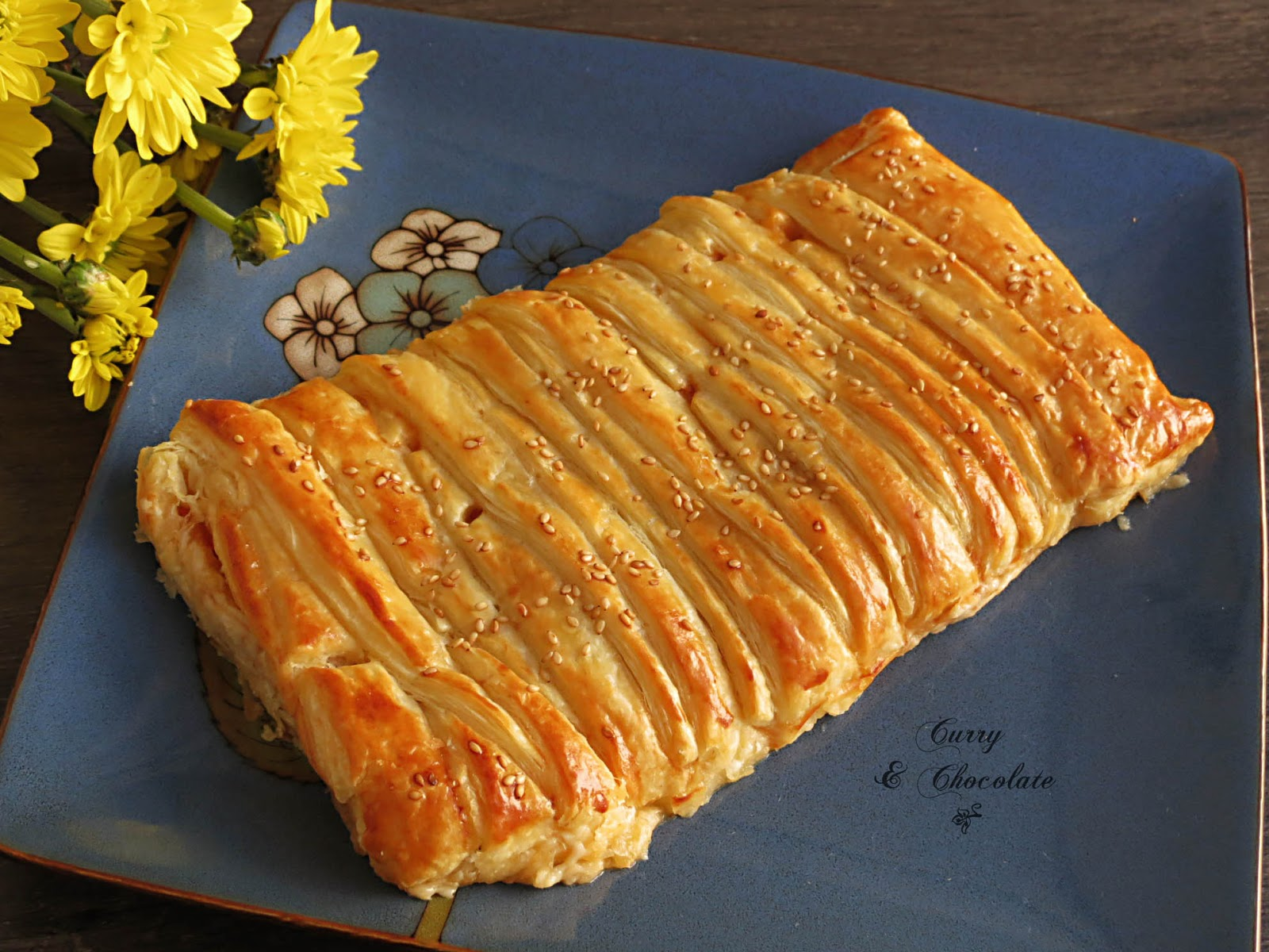 Trenza de hojaldre rellena de pisto, jamón cocido y queso havarti