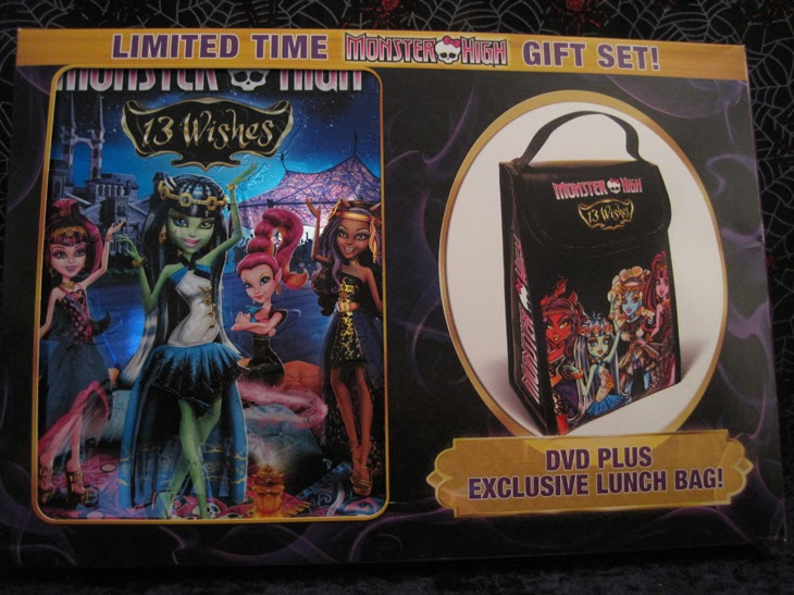 The outer packaging for the Walmart Monster High: 13 Wishes DVD gift set with included lunch bag.