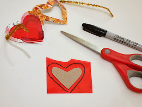 Tape on red cellophane to heart shaped glasses