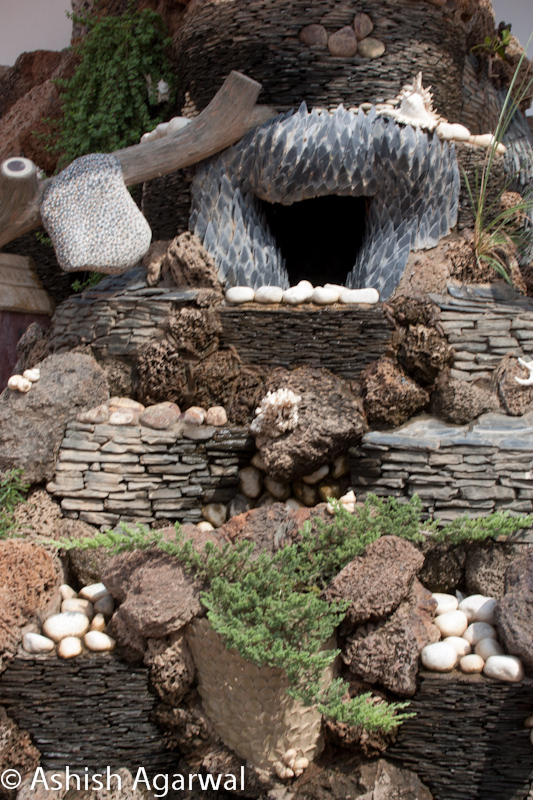 Small water fountain with decoration of rocks and greenery