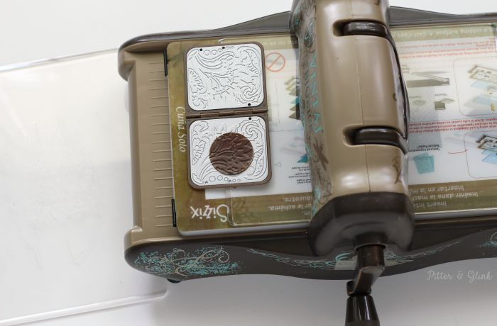 Embossing a Vintaj metal blank using the Sizzix BIGkick. |AD| www.pitterandglink.com