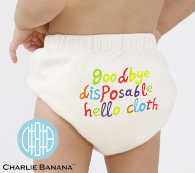 An Infant wearing a Charlie Banana cloth diaper with the phrase goodbye disposable hello cloth on the bottom.  I will review them when I have a chance to try them out