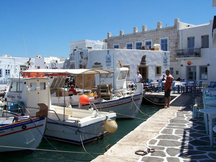 Probably the most typical of the Greek islands and a convenient base for island hoping around the Cyclades due to its excellent ferry connections. The beaches, the nightlife and the accomodation choice are all above average and many holiday makers return year after year. Parikia with its lovely old town is the capital and the port of Paros, but most nightlife is concentrated in piqturesque Naousa. Regular international windsurfing competitions are held at noisy Chrysi Akti beach but you can easily find quiet and isolated beaches if all you want is to relax and enjoy the blue waters. And if really quiet holidays are more up your street, Antiparos is the tiny and alternative neighbour just minutes away on a local boat.