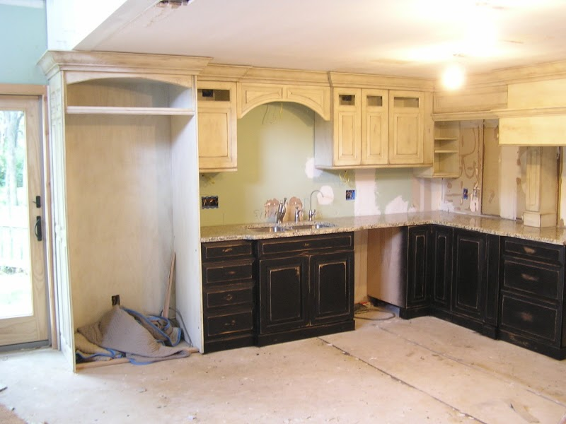Kitchen trends distressed black kitchen cabinets for Black kitchen furniture