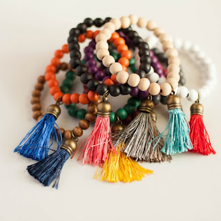 http://farmgirlboutique.com/product/wooden-tassel-bracelet-various-colors/