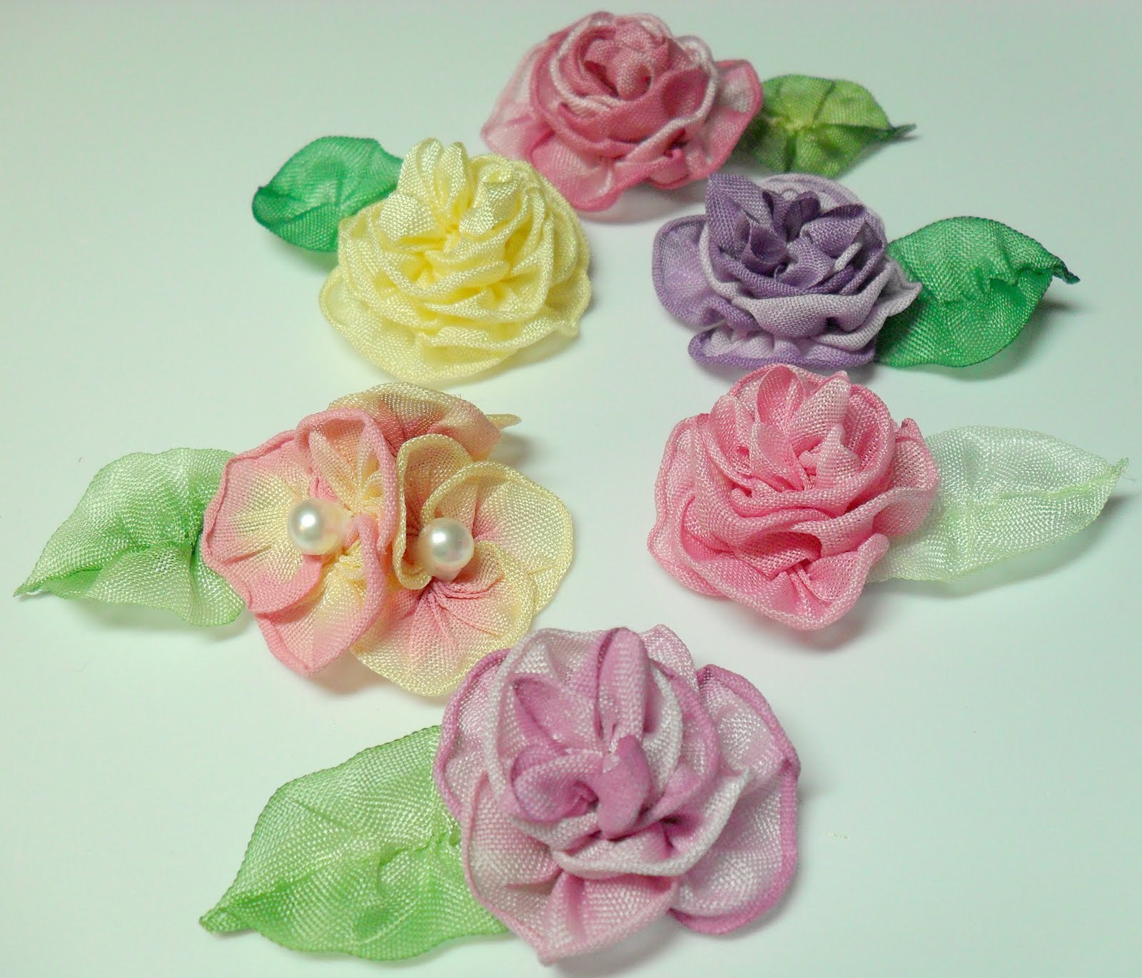 Ribbon Work Designs http://lambsandivydesigns.blogspot.com/2011/07/ribbonwork-ribbon-flowers-for-mary.html