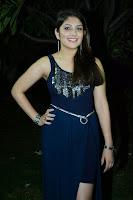 Ishita Gorgeous Pics in Shining Sleeveless Blue Dress at Nee Naan Nizhal Audio Launch  Chennai