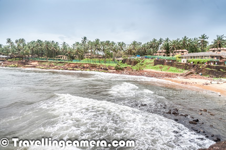 Sinquerim beach is first beach in Goa when we go from Panjim towards north part of Goa. This beach is 14 kilometers from Panjim and located near Aguada Fort . This Photo Journey shares some of the photographs clicked around Sinquerim Beach in Goa.Almost all the beaches in Goa was quite different although you can find subtle similarity among all the beaches in North vs South. We drove to Vivanta by Taj which oversees the Sinquerim beach. There is sufficient parking space. We parked the car and walked towards a huge fort structure just on the beach.This fort structure offers great views of powerful sea waves. I also tried to make a time-lapse video of these waves and failed miserably.There is awalking area around the fort wall, which offers great views of the sea and Sinquerim beach. Towards the end,there are few places to sit and relax. There are some really peaceful places where you can sit and hear the sounds of sea waves.One can see fishermen boats at the long distance. How many boats you see depends upon the weather and time of the day.This photograph was clicked while dirving back to Panjim from Sinquerim beach. There are multiple routes to reach a place in goa and some of the internal roads take you through some of the beautiful places. Agriculture is also one of the main occupations of Goan people. During monsoons, one can find lot of paddy fields around.Here is a photograph showing Vivanta by Taj which is just opposite to Sinquerim beach in Goa.Tourists enjoying the sea waves around Sinquerim beach.Sinquerim beach is relatively cleaner and less crowded, as compared to other beached in North Goa. Although water sport activities are little expensive at Sinquerim beach. This is a lovely place near Vivanta by Taj, where you can sit for long hours and enjoy activities happening around the sea.
