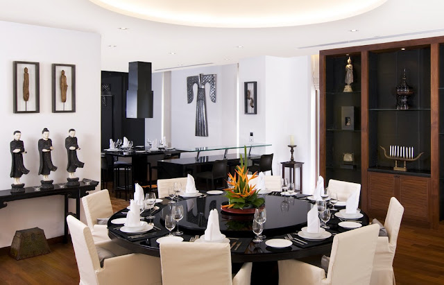 Picture of the round black dining table and modern white chairs