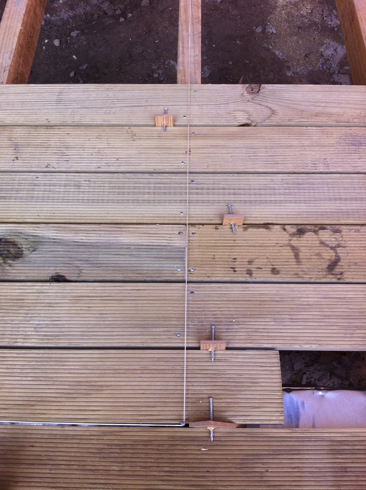 The joy of wood building a timber deck for Timber decking spacers