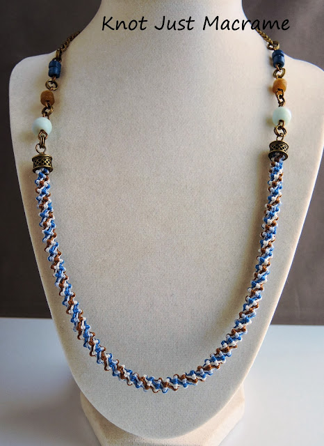 Necklace by Sherri Stokey with spiral micro macrame center