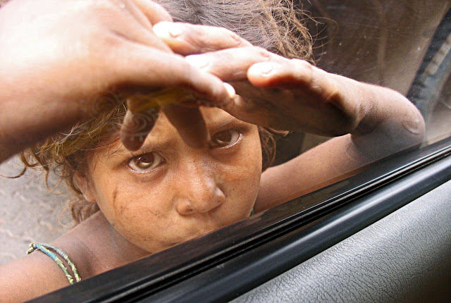girl with face pressed against the window