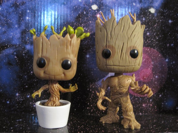 Funko Pop! Dancing Baby Groot and original Groot figures side by side.