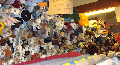 This photo shows the staggering amount of fabric in just a small part of the room in which everything costs £1 per metre.