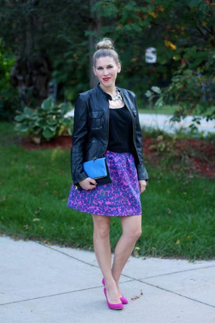 black tank, black moto jacket, pink and blue floral skirt, statement necklace, blue Clare V. clutch, pink heels