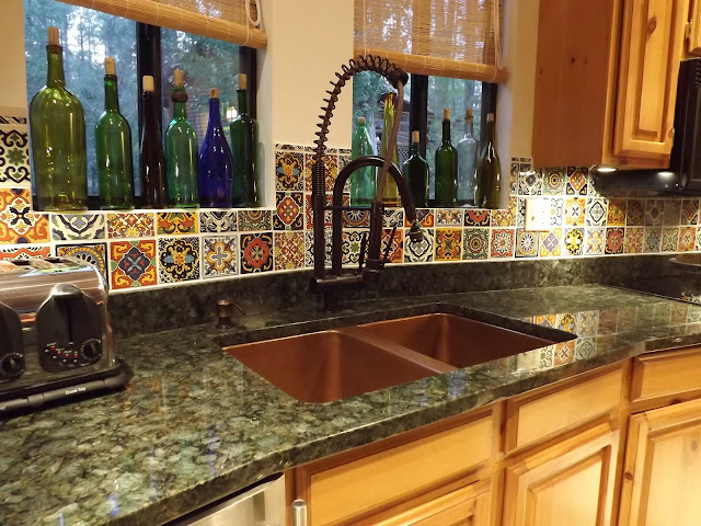 mexican tile backsplash, copper sink, verde peacock granite counter, talavera tile backsplash