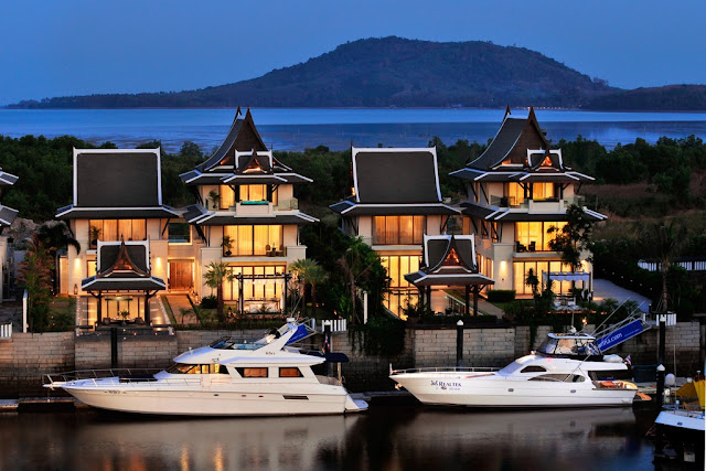 Picture of two modern villas with private yacht docks and yachts