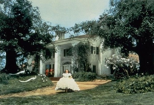 Vivien Leigh as Scarlet O'Hara running outside Tara in Gone with the Wind movieloversreviews.filminspector.com