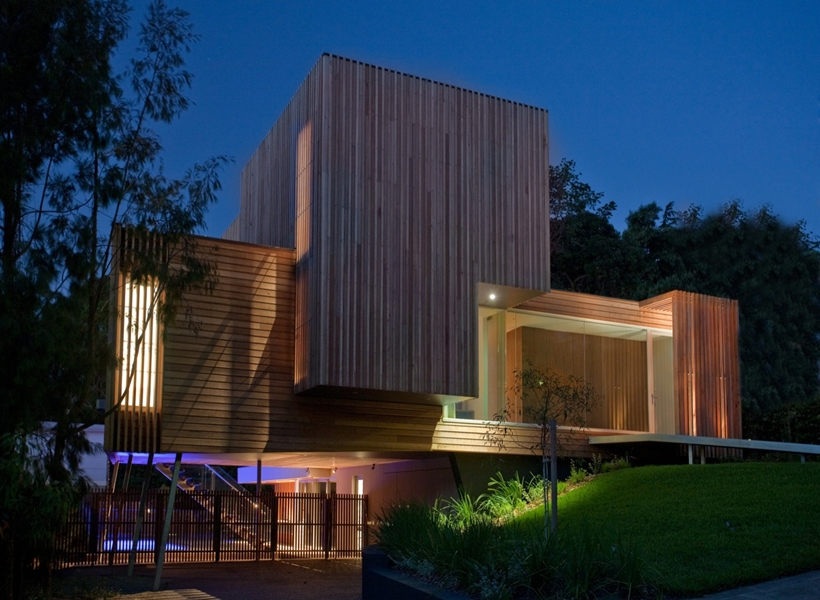 Lights and wooden facade on Kew House by Vibe Design Group