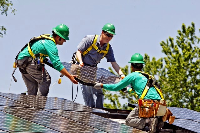 Solar City employees install a solar panel on a home in south Denver. (Credit: AP /Ed Andrieski) Click to enlarge.
