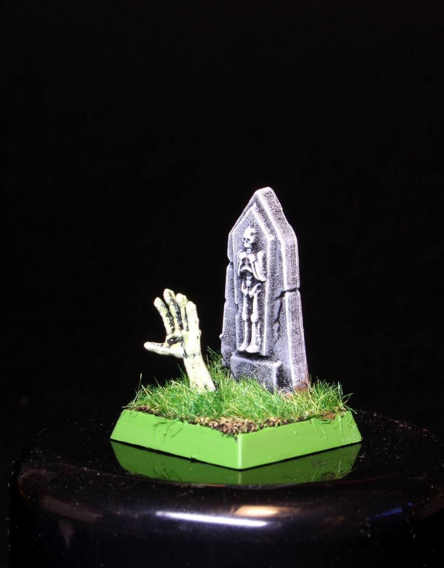 Zombi saliendo de su tumba