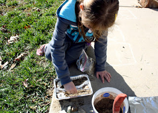 After helping Tessa fashion a river bed from aluminum foil, she added pointed white rocks from our driveway in Upper Egypt to stand in as snow-capped mountains. Then, she sprinkled grass seed onto the banks of her soon-to-be Nile to mimic the planting of crops.