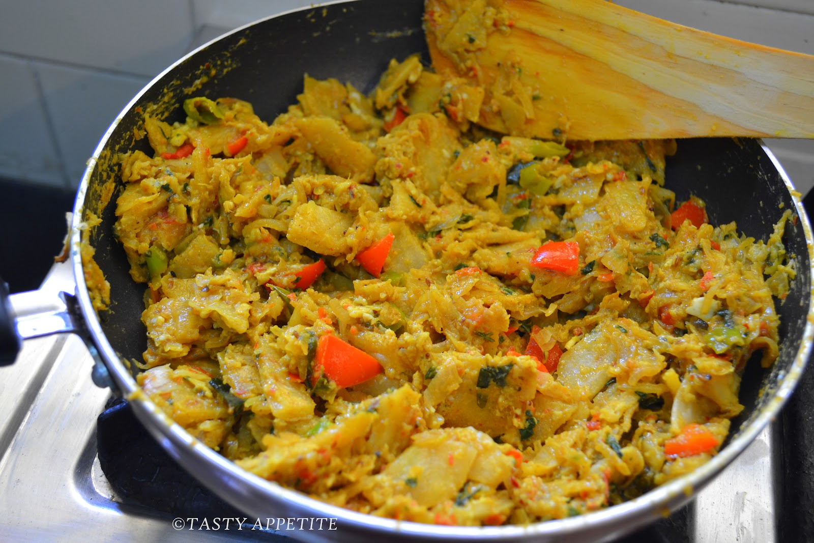 Now Bring The Flame To Low Medium And Cook The Eggs Together With Minced Parotta Until The Masala Turns Dry