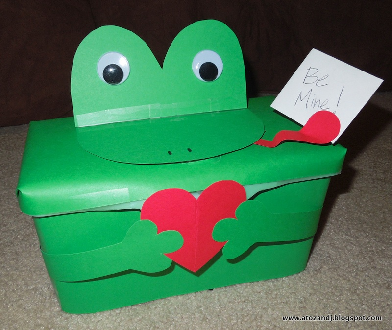 the frogs mouth opens to put the valentines in or you can open the lid for larger items of course jameson has taken it from me already and keeps feeding