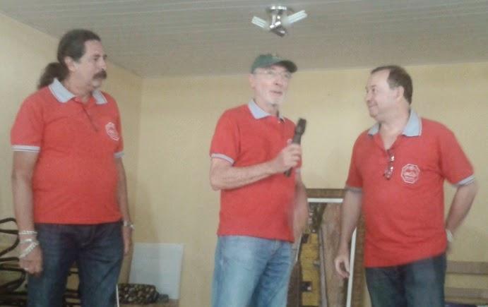 Romeu Nardini, Percival Lafer e Walter Arruda no palco da festa.