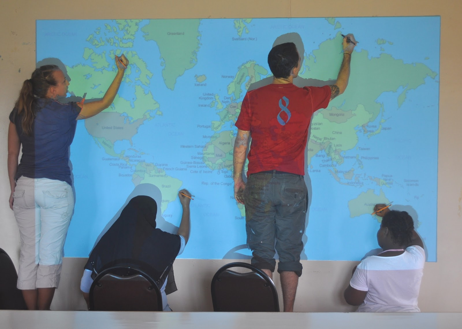 Its always sunny in guyana world map project surrounding community come and help draw and paint the mural in just two days what was once a blank wall now displays a pretty big and awesome map gumiabroncs Images