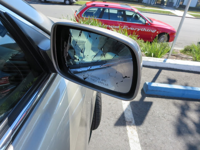 Cracked mirror on Toyota Camry before replacement at Almost Everything Auto Body